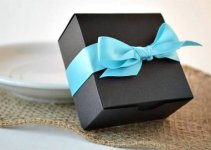 wedding favor boxes - black box with blue ribbon