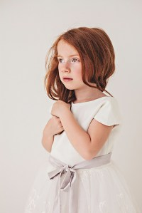 white lace flower girl dress with purple bow sash
