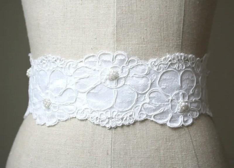 white sash made of lace and tulle | NEW Wedding Dress Sash Ideas via http://emmalinebride.com/bride/wedding-dress-sash-ideas/