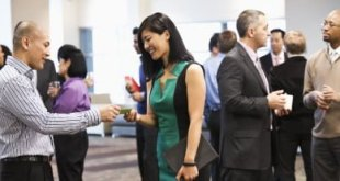 Exchanging business cards at conference