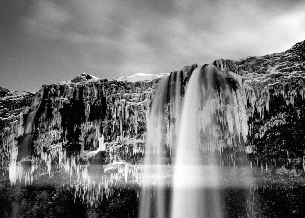 Seljalandsfoss with light leak. Zuiko 35mm F2.0; settings not recorded; TMax 100 in Rodinal (stand).