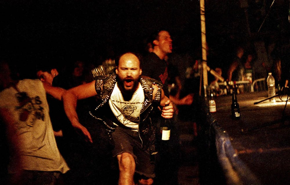 Fattal Fest - A brief moment of connection in a dark and chaotic mosh pit at an underground punk festival in Montreal's Saint-Henri neighborhood. Canon F-1, Agfa Vista 400 Plus at EI 1600