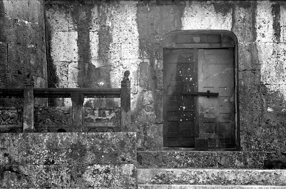 Barred - Shot on Silberra ULTIMA 200 at EI 200. 35mm black and white format film. Orange #25 filter. Leica M6 / Leica Tele-Elmarit 90mm f/2.8.