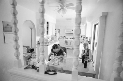 Breakfast - A mom feeds her child breakfast in her suburban home, Albuquerque NM, August 2017 (Nikon F100, 20mm, ILFORD HP5 Plus) Kenneth - Wajda Photographer
