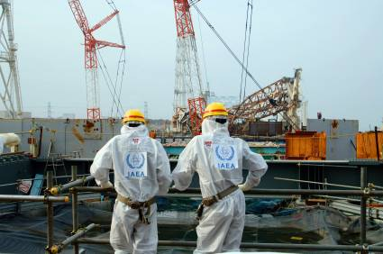 IAEA review mission members examine recovery work at TEPCO's No.4 reactor building at the tsunami-crippled Fukushima Daiichi Nuclear Power Plant