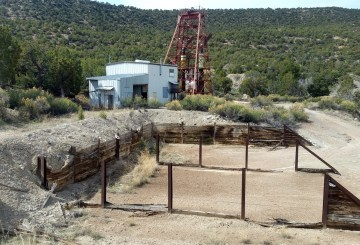 The ore pad of this abandoned uranium mine would have been filled with uranium ore waiting to get transported to nearby uranium mills for processing when the mine was operating.