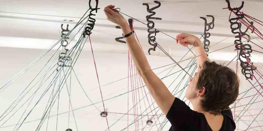 Denise Milstein weaving web
