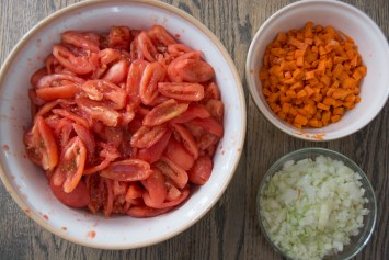 Peeled tomatoes, diced carrots and onions