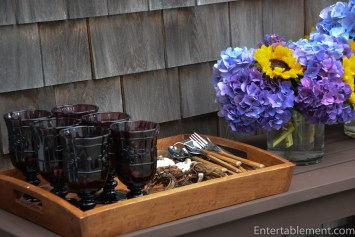 Glassware, napkin rings & cutlery on a sturdy tray from Pottery Barn.