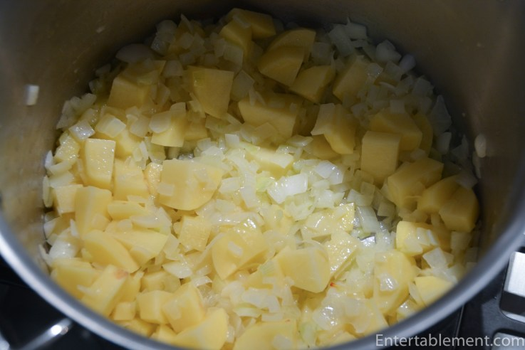 Sauté the onion and add the potatoes