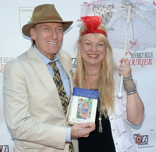 Mr. & Mrs. Ed Lauter, holding F. Scott Fitzgerald's book, The Great Gatsby, at Celebrity Polo Match