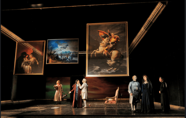 Raked stage, translucent portraits, trapdoors and superb lighting. Photo by Cory Weaver.