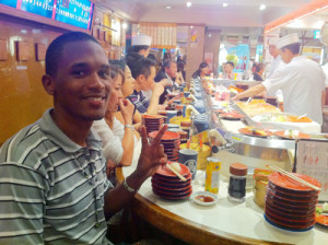 Kelroy Brown in a sushi restaurants in Japan