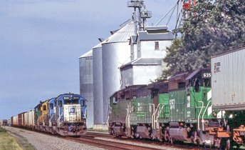 two trains carrying freight pass each other