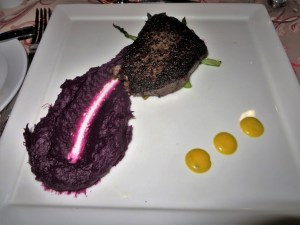 A 5 Wagyu filet with asparagus and purple sweet potato puree.