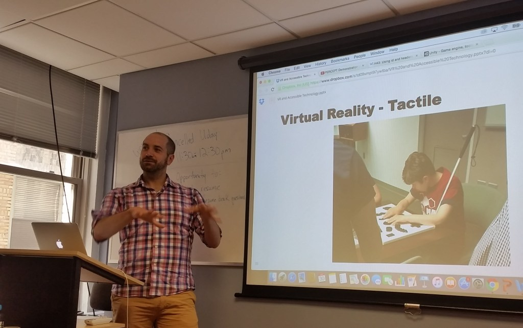 Thomas Logan, Equal Entry CEO, speaks with students at the New York Code and Design Academy