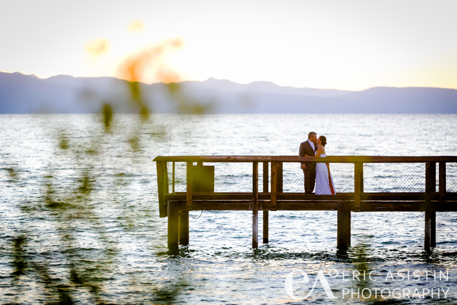 Jennifer and Ryan kiss on the south fork of the pier at Lakeland Village South Lake Tahoe, CA