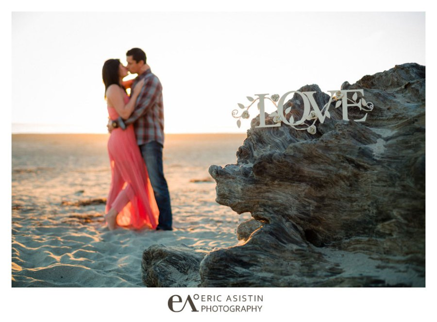 Engaged couple share a beautiful setting at an empty Rio Del Mar Beach Santa Cruz CA
