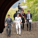 Chuck Bass (played by Ed Westwick-in a tuxedo custom made by Martin Greenfield, Eton shirt, Dolce and Gabbana shoes, and Bruno Piatelli socks) races through New York City's Central Park to get to his bride-to-be Blair Waldorf (Leighton Meester) before the Police get to her first!