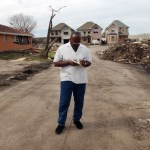 Eric covers the aftermath of Hurricane Katrina. Photo credit: Willie J. Allen Jr.