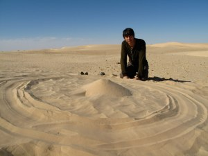 Professor Brian Cox drawing Saturn and the moons in the Sahara Desert. From Wonders of the Solar System.