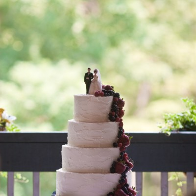 Our perfect wedding cake was filled with layers of chocolate ganache and strawberry jam.