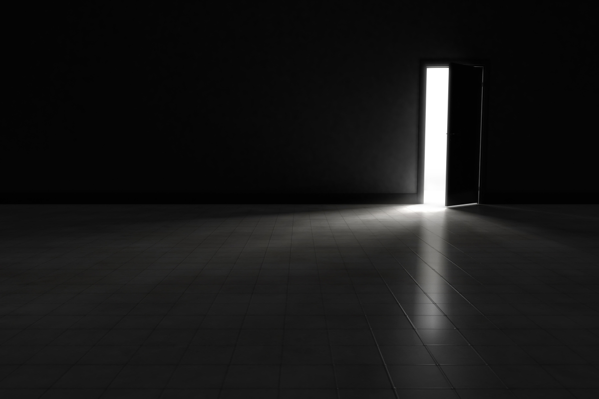 Open door to dark room with bright light shining in for Door with light