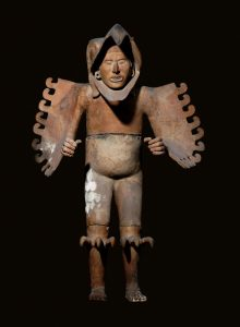 Wings outspread, jagged talons projecting front and back from his knees, his face emerging from an eagle's beak, this is an eagle warrior. Templo Mayor Museum, INAH. National Council for Culture and Arts – INAH.