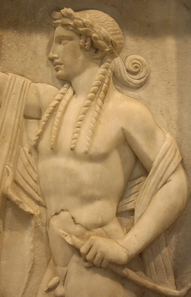 Apollo, detail from a 2nd century CE funerary relief slab.