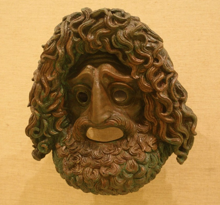 A votive offering in a the form of a larger-than-life bronze tragedy theatre mask. Possibly by Silanion, 4th century BCE.
