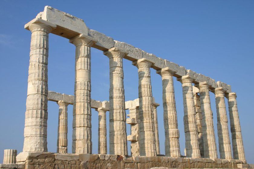 The temple of Poseidon was constructed in approx. 440 B.C., over the ruins of a temple dating from the Archaic Period. It is perched above the sea at a height of almost 70 m. The design of the temple is a typical hexastyle i.e. it had a front portico with 6 columns. Only some columns of the Sounion temple stand today, but intact it would have closely resembled the contemporary and well-preserved temple of Hephaestus beneath the Acropolis, which may have been designed by the same architect. As with many GreekGreek temples, the Poseidon building was rectangular, with a colonnade on all four sides. The total number of original columns was 36: 18 columns still stand today. The columns are of the Doric Order. They were made of locally-quarried white marble. They were 6.10 m (20 ft) high, with a diameter of 1 m (3.1 ft) at the base and 79cm (31 inches) at the top. Photo © Mark Cartwright.