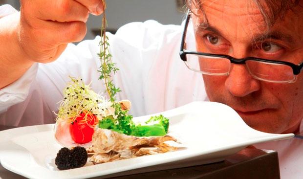 chef garnishing the food