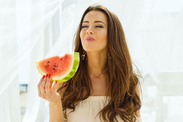 girl enjoying watermelon