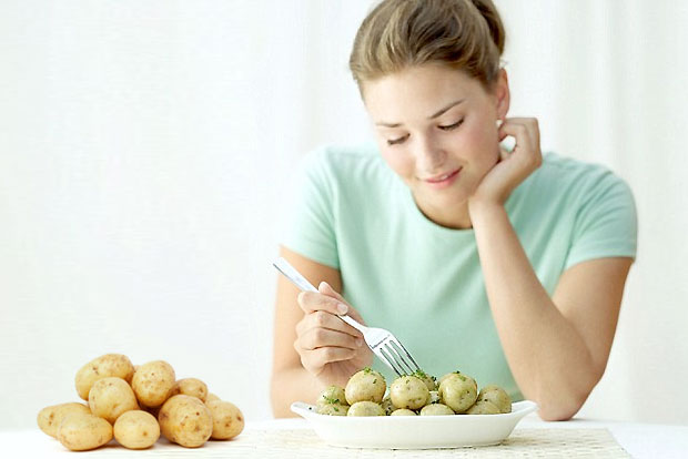 woman eating potato