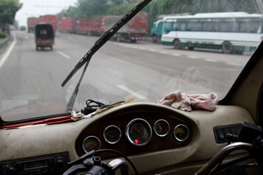 The approach to the market as seen from Liu's vehicle – notice the trucks.