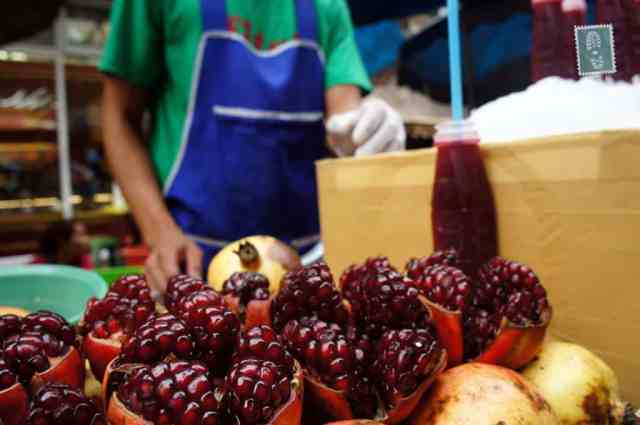 Fresh pomegranate juice in China Town