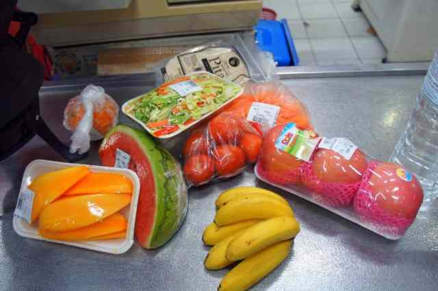 Fruits and veggies we always bought in local stores for long bus rides- some bananas, apples, papaya and carrots.