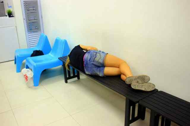 A girl having a nap in a laundry room