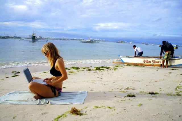 A girl blogging at Alone Beach, the Philippines