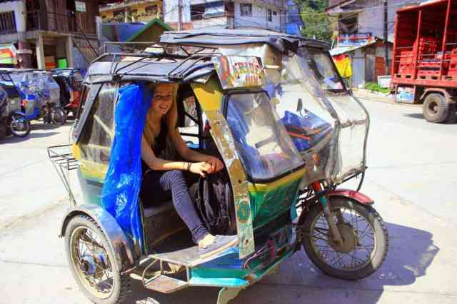 A girl in a tricycle