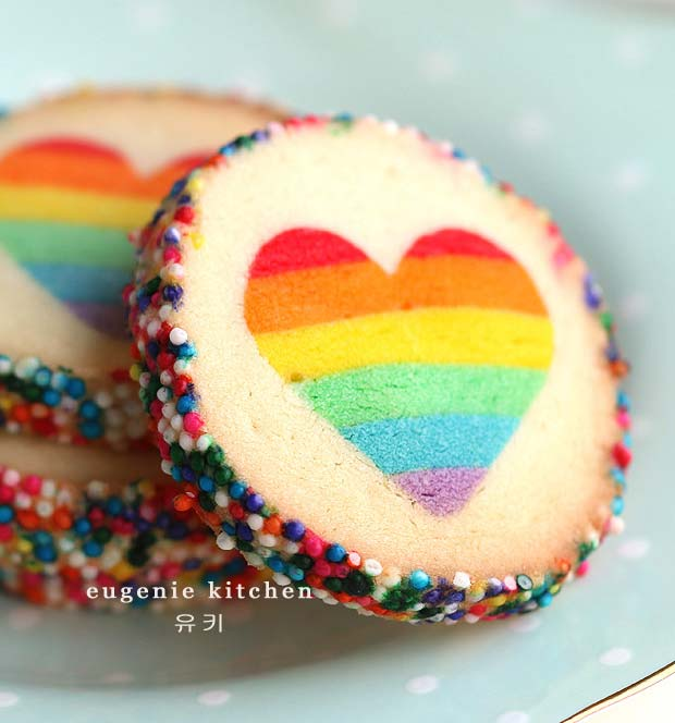 """Make These Rainbow Heart Cookies And Prove You're Truly In Love"" Valentine Rainbow Heart Cookies - Eugenie Cookies"