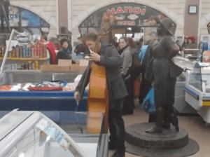 "A cellist performs the opening bars of Beethoven's ""Ode to Joy"" at Privoz market in Odesa"