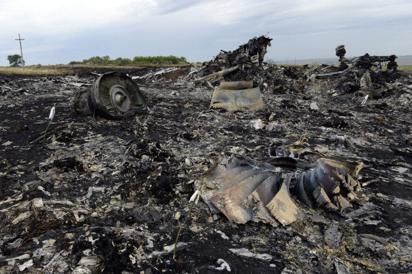 Debris at the site of the crash of a Malaysia Airlines flight MH17 with 298 people aboard downed by Russian BUK surface-to-air missile in Russia-occupied east Ukraine, on July 19, 2014. (Image: Alexander KHUDOTEPLY/AFP/Getty Images)