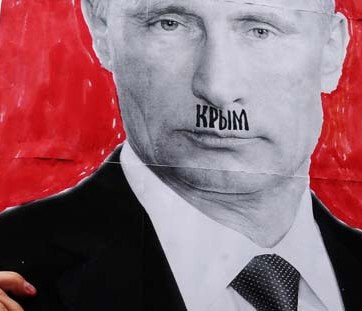 "A portrait of Putin with ""Crimea"" written on the upper lip"