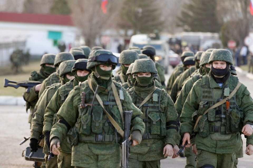 "In a hybrid war operation, Russian ""little green men"", heavily armed soldiers without insignia, annexed Crimea from Ukraine"