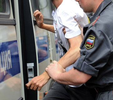 Russian policeman with an arrested