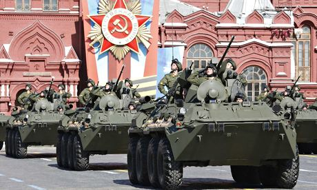 Troops in armoured personnel carriers salute during the Victory Day parade. Photograph: Grigory Dukor/Reuters