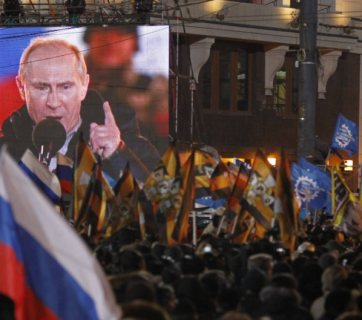 People rally in support of Russian Prime Minister and presidential candidate Vladimir Putin in Moscow, 2012. (AP Photo/Misha Japaridze)