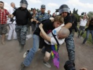 Anti-gay campaigners clash with gay rights activists during a rally in Russia [Reuters].