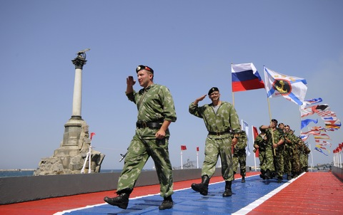 Russian marines march along the embankment of Sevastopol, Crimea, during a celebration of the Navy Day on Sunday, July 26, 2015. (Image: AP Photo/ Alexander Polegenko)